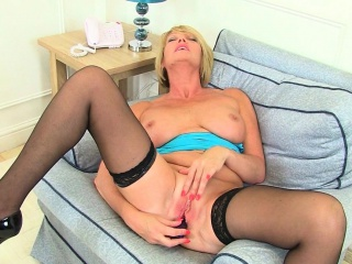 British milf Sulky strips off together with teases the brush pussy