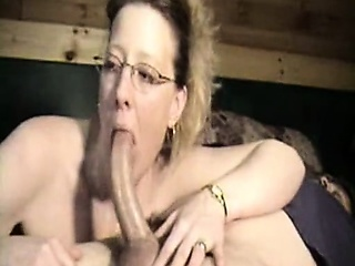 Milf concerning glasses sucking essentially dick madly