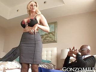 Chunky breasted MILF invites a stallion for interracial plowing