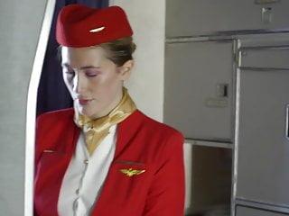 Serving-woman fucks a tourist on a plane